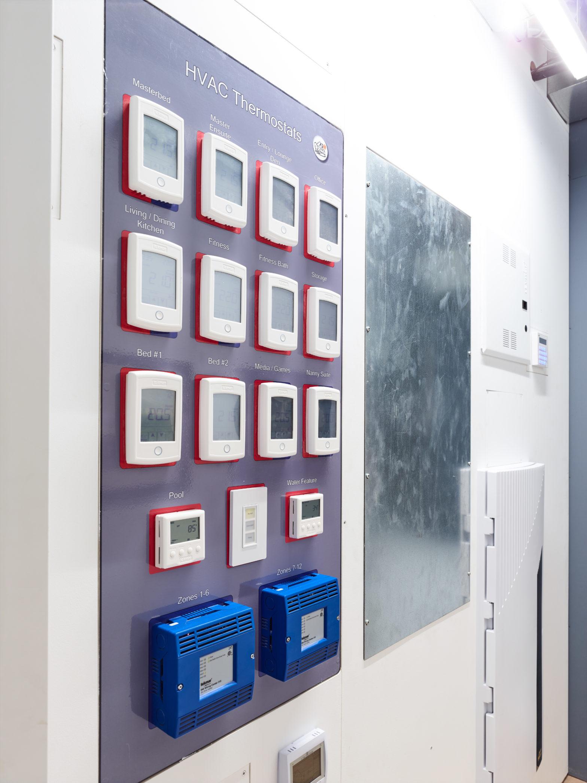 HVAC controls hidden in Utility Room